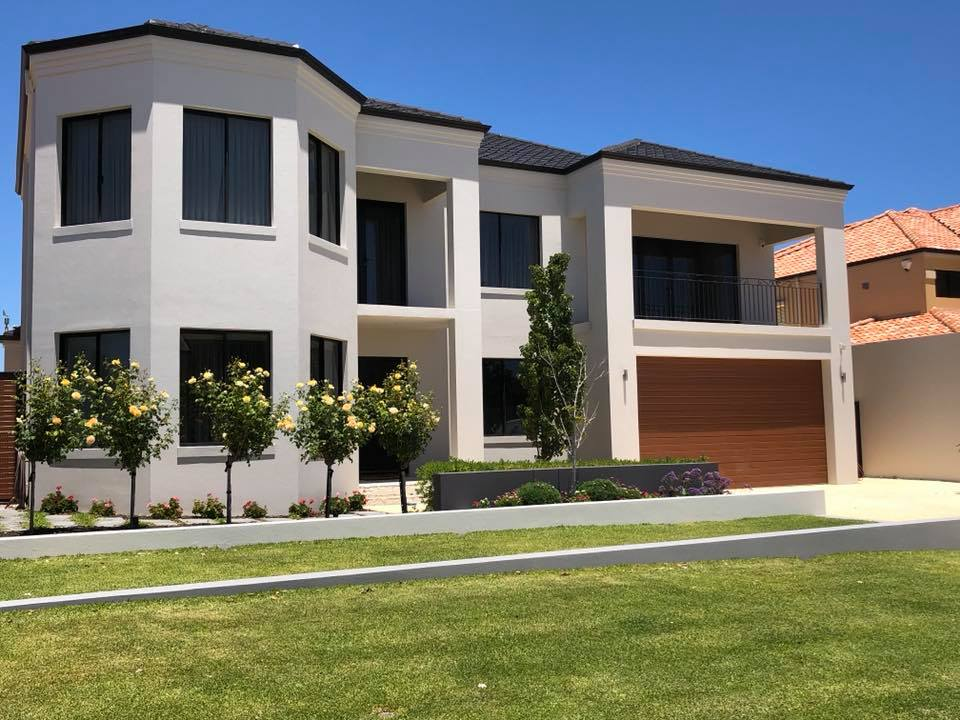 Exterior render repaired house